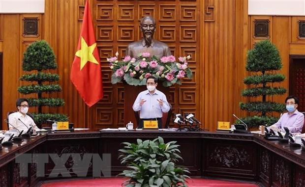 Le Premier ministre travaille avec le ministere de la Sante hinh anh 2