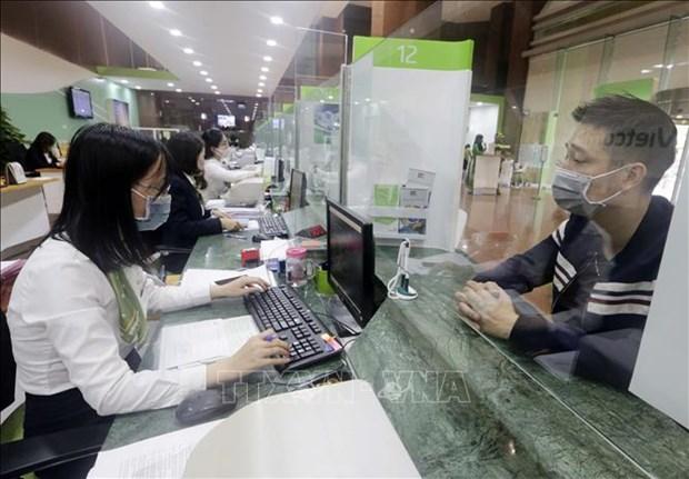 COVID-19 : de nombreuses banques baissent des taux d'interet pour assister leurs clients hinh anh 1
