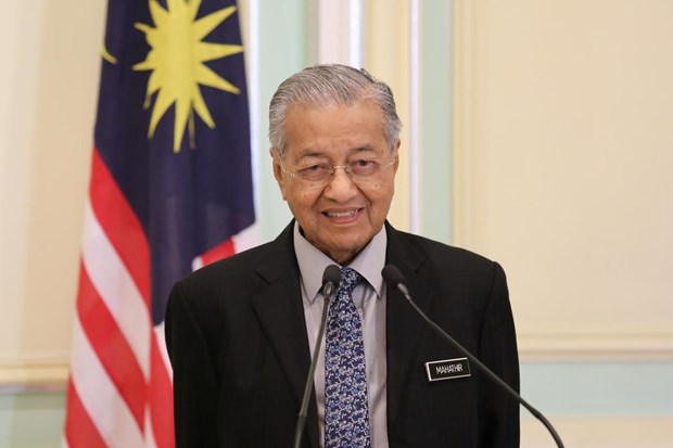 Le Premier ministre malaisien Mahathir Mohamad remet sa demission au roi hinh anh 1