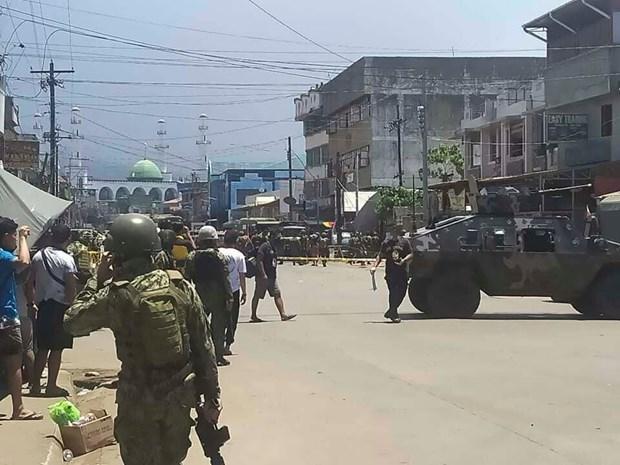 Double explosion aux Philippines : Au moins dix morts et 17 blesses hinh anh 1