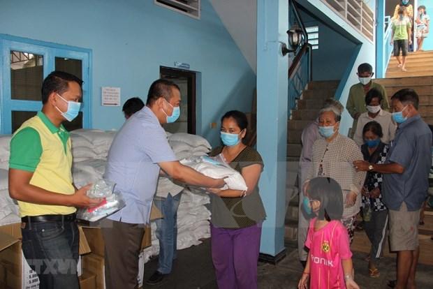 COVID-19 : Aide d'urgence accordee aux menages d'origine vietnamienne au Cambodge hinh anh 1