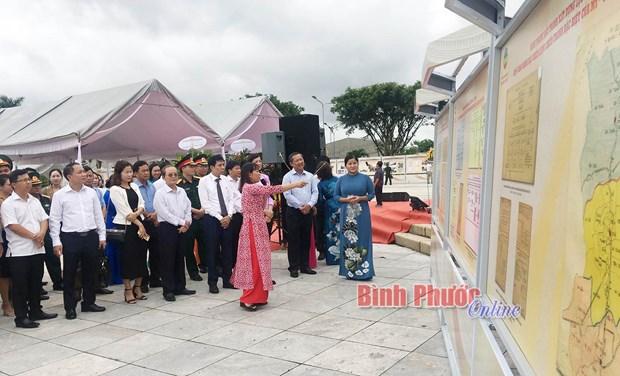 Binh Phuoc : Exposition de documents sur la guerre de resistance et la construction nationale hinh anh 2