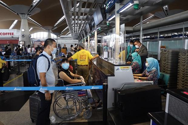 COVID-19: Rapatriement de plus de 290 Vietnamiens de la Malaisie hinh anh 1