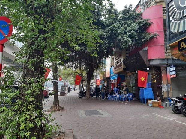 13e Congres national du PCV: Hanoi se pare des couleurs du drapeau national hinh anh 1