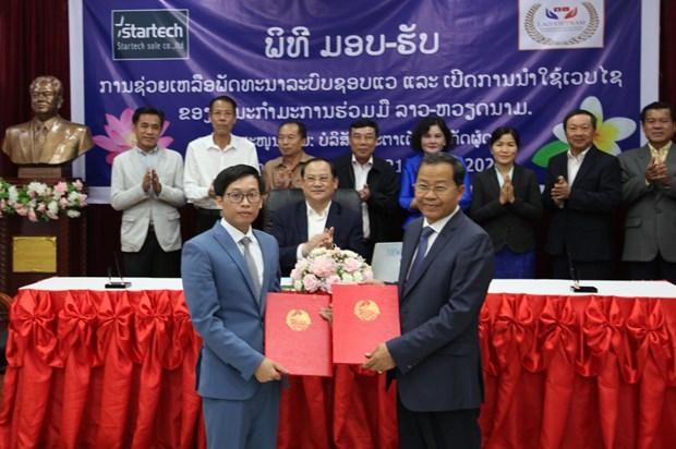 Inauguration du site Web du Comite de cooperation Laos-Vietnam hinh anh 1