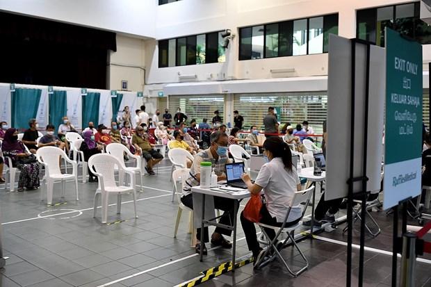 Singapour: La vaccination anti-COVID-19 est desormais ouverte aux citoyens ages de 45 a 59 ans hinh anh 1