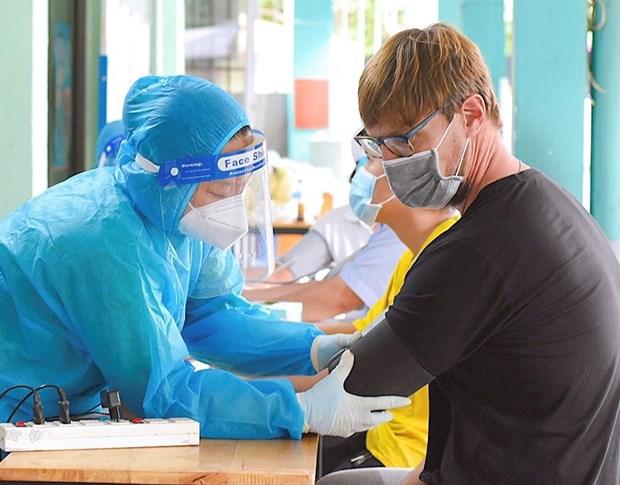 Vaccination pour des residents etrangers a Ho Chi Minh-Ville hinh anh 1