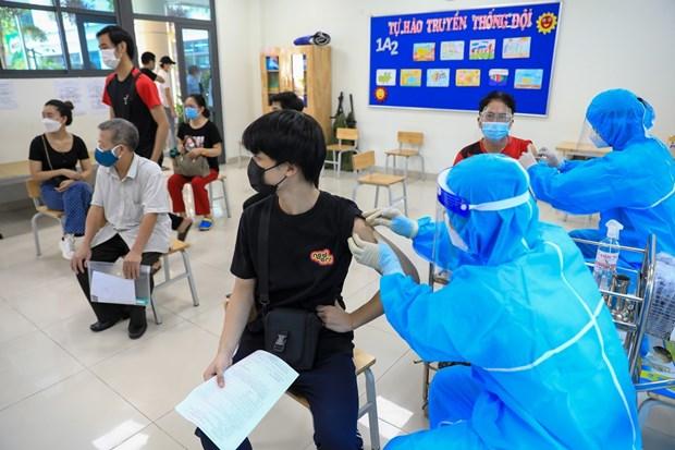 COVID-19: le Vietnam prevoit de vacciner pour toute la population agee de plus 5 ans en 2022 hinh anh 1