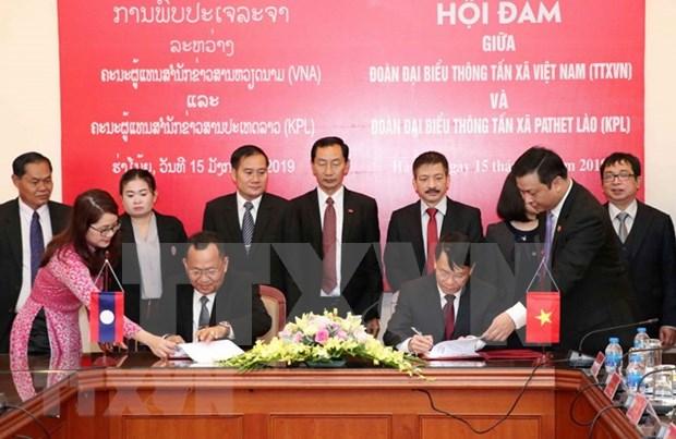Une delegation de l'agence de presse laotienne KPL en visite au Vietnam hinh anh 2