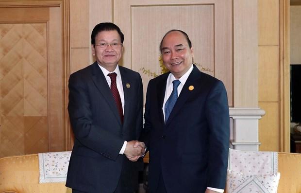 Le PM lao au Vietnam pour renforcer les liens speciaux hinh anh 1