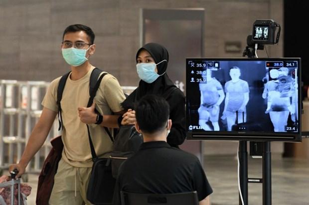 COVID-19: Singapour refuse les visiteurs ayant voyage en Iran, au nord de l'Italie, en R. de Coree hinh anh 1
