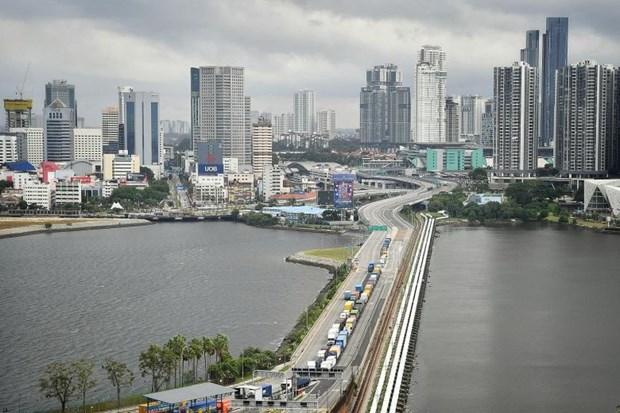 Singapour et la Malaisie conviennent d'autoriser les voyages transfrontaliers pour certains cas hinh anh 1
