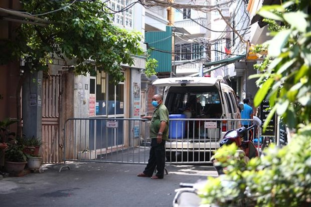 COVID-19 : mise en quarantaine de quelques endroits a Hanoi hinh anh 1