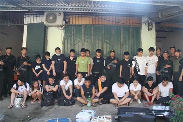 Vingt-et-un personnes recherchees par la police chinoise sont arretees a Lao Cai hinh anh 1