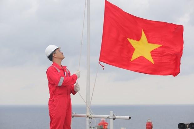 La ceremonie de salut au drapeau national de Biendong POC etablit un record de Guinness Vietnam hinh anh 1