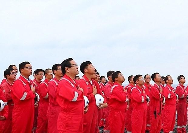 La ceremonie de salut au drapeau national de Biendong POC etablit un record de Guinness Vietnam hinh anh 2