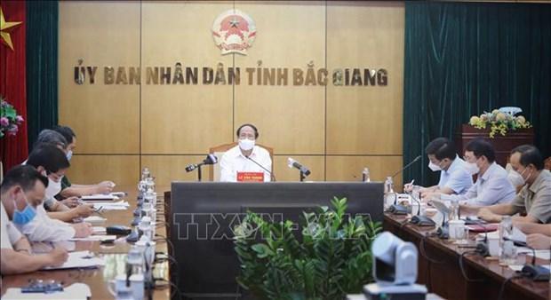 Ne pas laisser l'epidemie a Bac Ninh et Bac Giang se propager dans les zones sures hinh anh 3