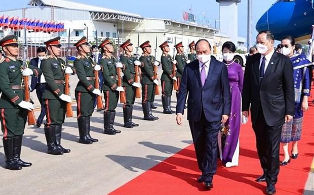 Le president Nguyen Xuan Phuc arrive a Vientiane pour une visite d'amitie officielle au Laos hinh anh 1