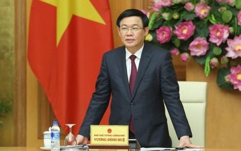 Le vice-Premier ministre Vuong Dinh Hue a une reunion de l'Union des cooperatives hinh anh 1