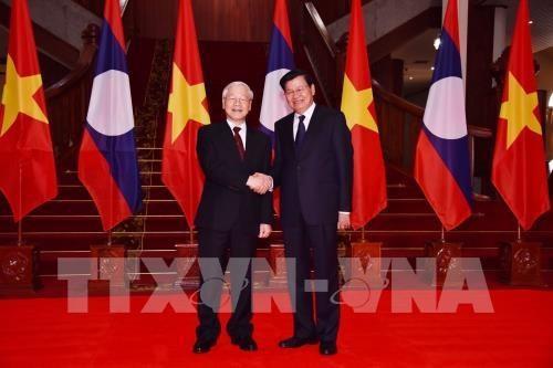 Le dirigeant vietnamien Nguyen Phu Trong rencontre des dirigeants laotiens hinh anh 1