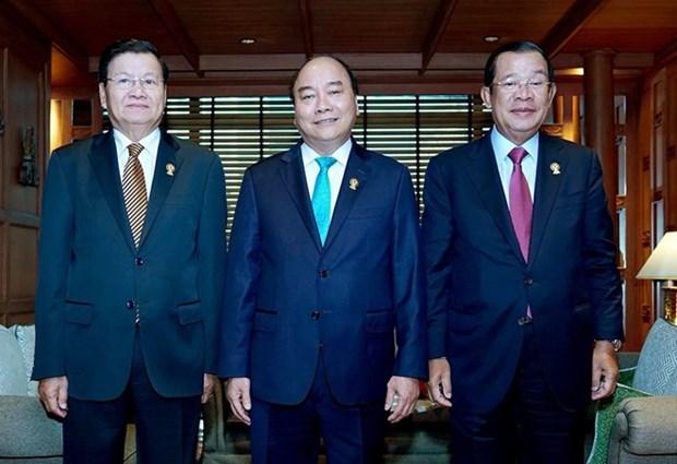 Le PM vietnamien rencontre ses homologues laotien et le cambodgien en marge du 34e sommet de l'ASEAN hinh anh 1