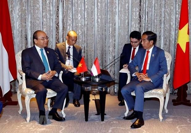 Le PM Nguyen Xuan Phuc rencontre des dirigeants en marge du 34e sommet de l'ASEAN  hinh anh 2