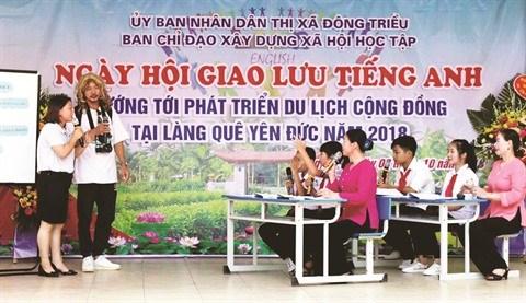 Quang Ninh: Apprendre l'anglais pour developper le tourisme local hinh anh 1