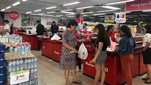 Saigon Co.op rachete le systeme de vente au detail Auchan hinh anh 1