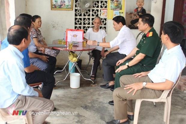 Activites a l'occasion de la Journee des invalides et des morts pour la Patrie hinh anh 1