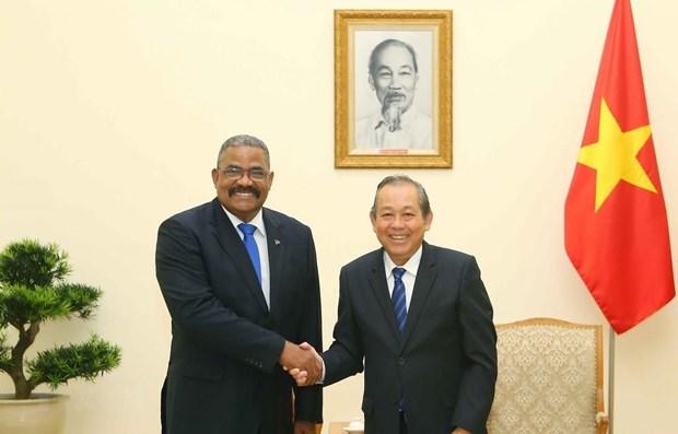 Le vice-PM permanent Truong Hoa Binh rencontre le president de la Cour populaire supreme de Cuba hinh anh 1