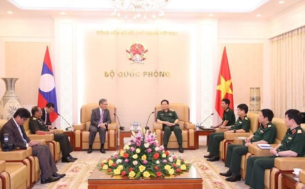 Le ministre de la Defense recoit l'ambassadeur du Laos hinh anh 1