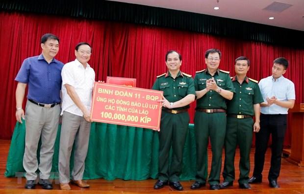 L'ambassade du Vietnam recueille des fonds pour les victimes des inondations au Laos hinh anh 1