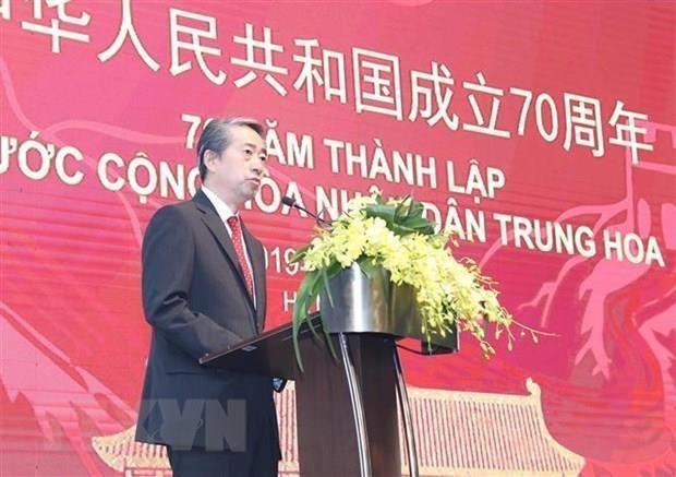 Rencontre d'amitie a Hanoi pour marquer le 70e anniversaire de la Fete nationale de la Chine hinh anh 1
