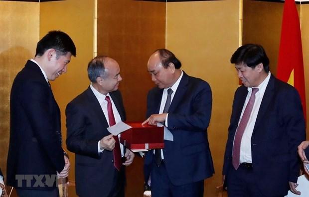 Le PM se felicite de l'expansion de l'investissement de SoftBank au Vietnam hinh anh 1