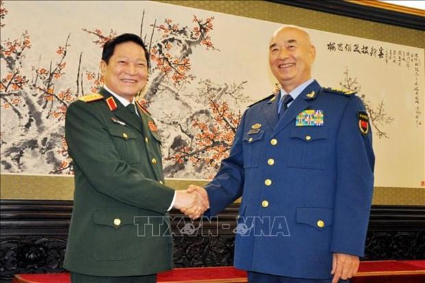 Promouvoir la cooperation en matiere de defense entre le Vietnam et la Chine hinh anh 1