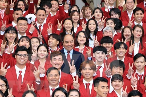 Le PM salue les efforts de la delegation sportive du Vietnam aux SEA Games 30 hinh anh 1