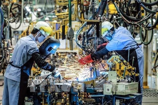 Le COVID-19 fait reculer l'indice du PMI du Vietnam en mars hinh anh 1