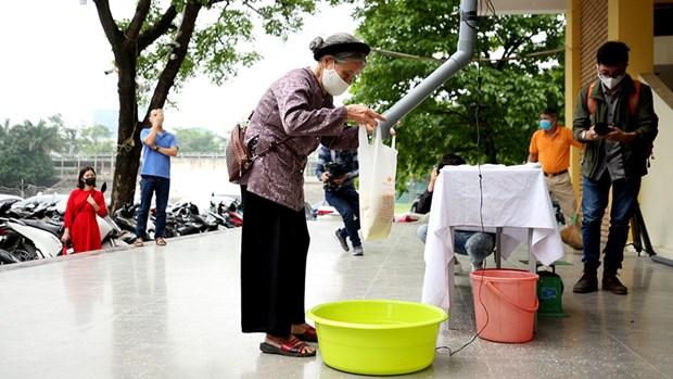 Premier «guichet automatique» de riz a Hanoi hinh anh 1