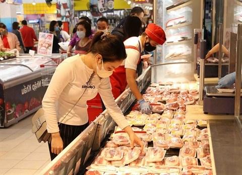 Big C lance sa campagne promotionnelle pour stabiliser les prix de la viande de porc hinh anh 1
