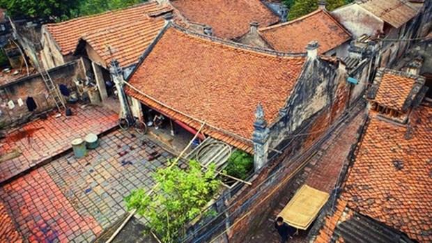 Visite du « paradis des vermicelles » et des maisons centenaires impregnees de l'ame vietnamienne hinh anh 1