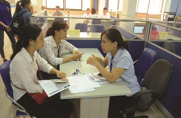 Hanoi accelere le decaissement des aides en faveur des plus vulnerables au COVID-19 hinh anh 1