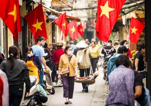 """Les Vietnamiens ressentent les """"fruits"""" de la lutte anti-epidemique hinh anh 1"""
