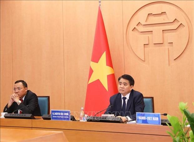 Hanoi partage son experience sur le combat contre le COVID-19 avec des maires du monde hinh anh 1