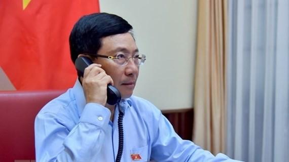 Les ministres vietnamien et koweitien des AE s'entretiennent par telephone hinh anh 1