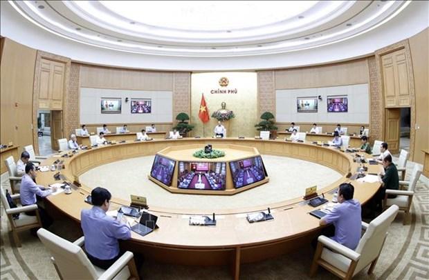 Le Premier ministre appelle a redoubler d'efforts contre la pandemie de COVID-19 hinh anh 1