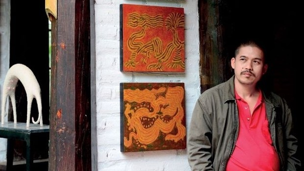 Un peintre vietnamien remporte des prix pour la promotion du patrimoine culturel immateriel hinh anh 1