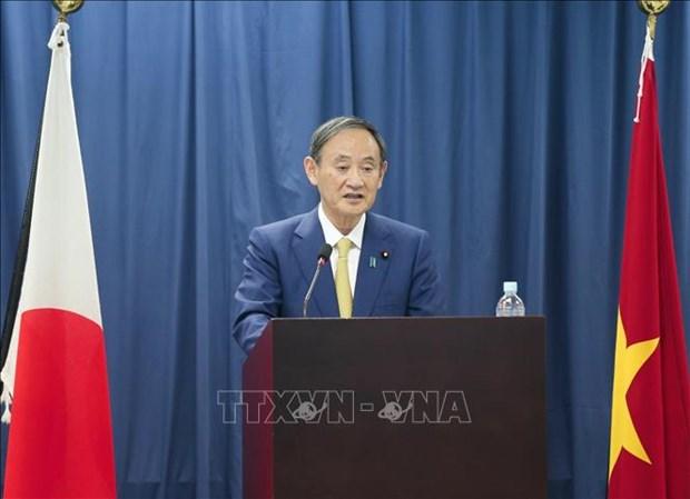 Le PM japonais rencontre des etudiants de l'Universite Vietnam-Japon hinh anh 1
