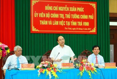 Le Premier ministre Nguyen Xuan Phuc travaille avec la province de Tra Vinh hinh anh 1