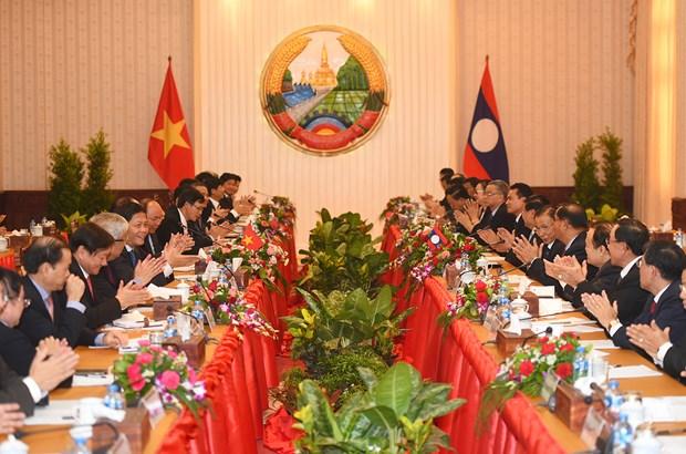 Vietnam et Laos affirment la determination de promouvoir leurs relations d'amitie traditionnelles hinh anh 1