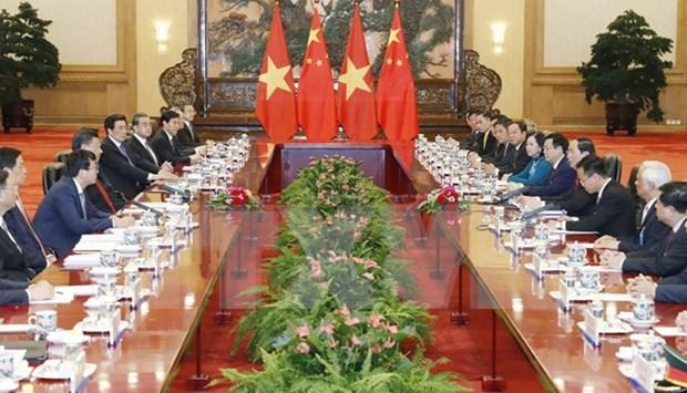 Vietnam-Chine : Entretien entre Tran Dai Quang et Xi Jinping a Pekin hinh anh 1